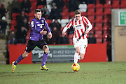 Harry Williams on the ball during the Sky Bet League 2 match between Cheltenham Town and Morecambe at Whaddon Road, Cheltenham, England on 16 January 2015. Photo by Shane Healey.