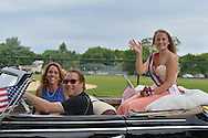 Wantagh, New York, USA. July 4, 2015. A contestant in The Miss Wantagh Pageant ceremony, a long-time Independence Day tradition on Long Island, rides in a luxury classic car in the town's July 4th Parade. After the parade, the Miss Wantagh Pageant 2015 ceremony was held. Since 1956, the Miss Wantagh Pageant, which is not a beauty pageant, crowns a high school student based mainly on academic excellence and community service.