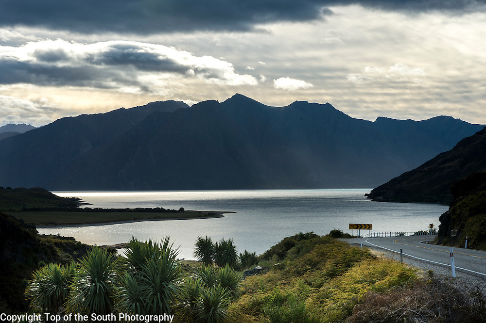 Lake Hāwea is located in the Otago Region of New Zealand, at an altitude of 348 metres. It covers an area of some 141 km&sup2; and is, at its deepest, 392 metres deep. Its name is Māori and is thought to be named after a local tribe though the exact meaning is uncertain.<br /> <br /> In 1958 the lake was raised artificially by 20 metres to store more water for increased hydroelectric power generation.<br /> <br /> At its greatest extent, which is roughly along a north-south axis, the lake is 35 kilometres long. It lies in a glacial valley formed during the last ice age, and is fed by the Hunter River. Nearby Lake Wanaka lies in a parallel glacial valley eight kilometres to the west. At their closest point (a rocky ridge called The Neck), the lakes are only 1000 metres apart. Lake Hāwea is dammed to the south by an ancient terminal moraine created some 10,000 years ago.<br /> <br /> The only flat land around the lake is at its southern end, surrounding its outflow into the Hāwea River, a short tributary of the Clutha, which it joins near Albert Town. The settlement of Hāwea is found at the lake's southern shore.<br /> <br /> The lake is a popular resort, and is well used in the summer for fishing, boating and swimming. The nearby mountains and fast-flowing rivers allow for adventure tourism year-round, with jetboating and skiing facilities located nearby.<br /> <br /> In pre-European history, Hāwea had an important role, when, in the 1830s the Māori residents of Hāwea brought warning to the residents of the South Island east coast of a planned attack over alpine passes by a war party of the warrior Te Puoho.