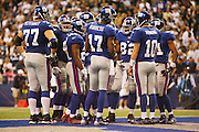 IRVING, TX - OCTOBER 23:  The New York Giants in a group huddle to call the next play against the Dallas Cowboys at Texas Stadium on October 23, 2006 in Irving, Texas. The Giants defeated the Cowboys 36-22. ©Paul Anthony Spinelli