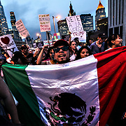 Manuel Camela, of Queens, took to the streets and crosses the Brooklyn Bridge with other protesters after President Donald Trump's Administration rescinded DACA to defend the act which benefitted illegal immigrant families.