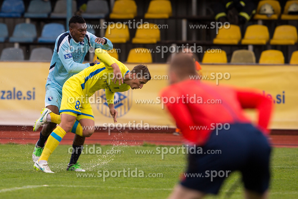 Uros Korun of NK Domzale and Chibuike Eleke of ND Gorica during football match between NK Domzale and ND Gorica in 28th Round of Prva liga Telekom Slovenije 2014/15, on April 18, 2015 in Sports park Domzale, Slovenian. . (Photo by Grega Valancic / Sportida.com)