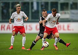 06.08.2014, Red Bull Arena, Salzburg, AUT, UEFA CL Qualifikation, FC Red Bull Salzburg vs Qarabag FK, dritte Runde, Rueckspiel, im Bild Peter Svarrer Ankersen, (FC Red Bull Salzburg, #4) und Ansi Agolli, (Qarabag FK, #25) //during UEFA Champions League Qualifier second leg 3rd round match between FC Red Bull Salzburg vs Qarabag FK at the Red Bull Arena in Salzburg, Austria on 2014/08/06. EXPA Pictures © 2014, PhotoCredit: EXPA/ Roland Hackl