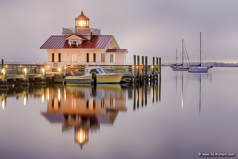 Roanoke Marshes Lighthouse with low clouds and fog rolling in, on the Outer Banks of NC.
