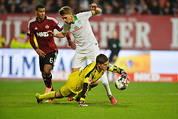 08.03.2014, easyCredit Stadion, Nuernberg, GER, 1. FBL, 1. FC Nuernberg vs SV Werder Bremen, 24. Runde, im Bild Patrick Rakovsky (1 FC Nuernberg / Mitte) kann den Ball vor Nils Petersen (Werder Bremen / dahinter) abwehren Links: Martin Angha (1 FC Nuernberg) Duell, Zweikampf, Action / Aktion // during the German Bundesliga 24th round match between 1. FC Nuernberg and SV Werder Bremen at the easyCredit Stadion in Nuernberg, Germany on 2014/03/08. EXPA Pictures © 2014, PhotoCredit: EXPA/ Eibner-Pressefoto/ Merz<br /> <br /> *****ATTENTION - OUT of GER*****