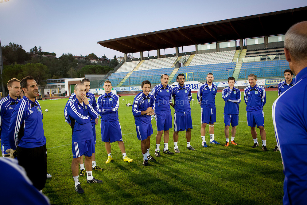 SERRAVALLE, SAN MARNO - 3 OCTOBER 2011: San Marino players joke during the briefing of the upcoming Euro 2012 qualification game against Moldova on October 11, in San Marino, San Marino on October 3, 2011. The San Marino national football team is the last team in the FIFA  World Ranking (position 203). San Marino, whose population reaches 30,000 people, has never won a game since the team was founded in 1988. They have only ever won one game, beating Liechtenstein 1&ndash;0 in a friendly match on 28 April 2004. The Republic of San Marino, an enclave surronded by Italy situated on the eastern side of the Apennine Moutanins, is the oldest consitutional republic of the world<br /> <br /> <br /> ph. Gianni Cipriano
