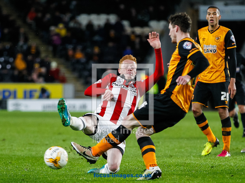 Ryan Woods of Brentford and Andrew Robertson of Hull City during the Sky Bet Championship match between Hull City and Brentford at KC Stadium, Hull<br /> Picture by Mark D Fuller/Focus Images Ltd +44 7774 216216<br /> 26/04/2016