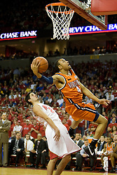 Virginia guard Calvin Baker (4) shoots after being fouled by Maryland guard Greivis Vasquez (21). The Maryland Terrapins defeated the Virginia Cavaliers men's basketball team 85-75 at the Comcast Arena in College Park, MD on January 30, 2008.