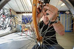 LUXEMBOURG CITY - SEPT-9-2012 -  Mingo De Silva, a manager at Velo en Ville, the city's bike rental shop, located in the Grund, makes repairs to his rentals. (Photo © Jock Fistick)