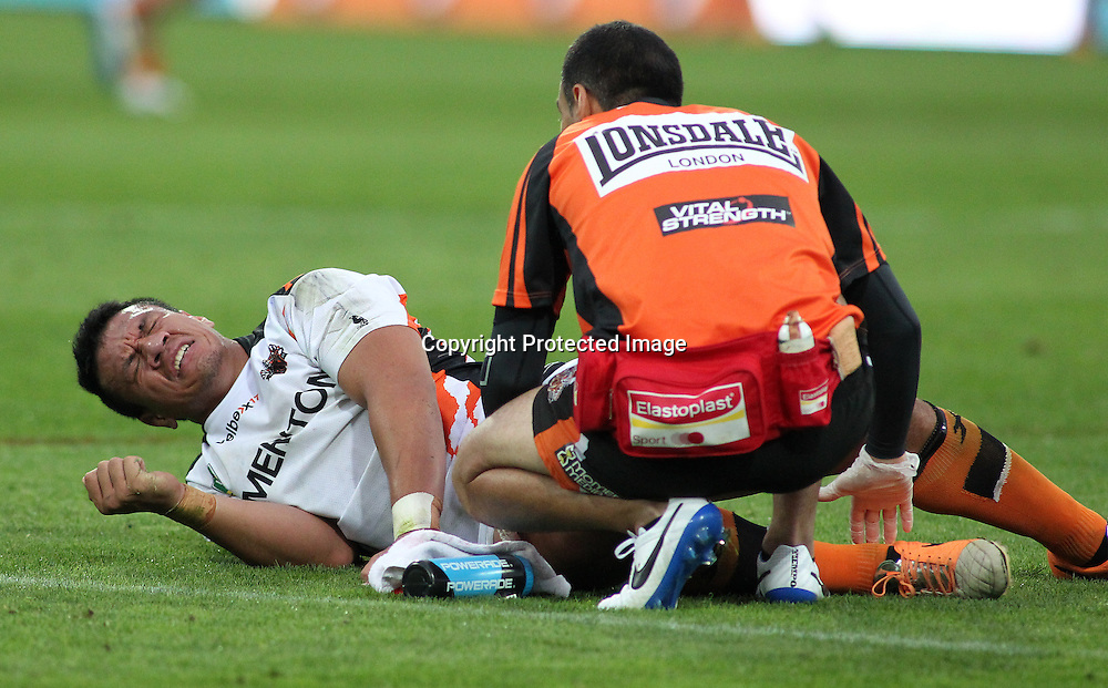 West's Tigers' Sauaso Sue goes down injured during the NRL match between The Warriors v Wests Tigers. Westpac Stadium, Wellington. 29 March 2014. Photo.: Grant Down / www.photosport.co.nz