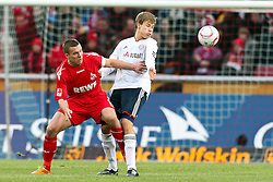 05.02.2010,  Rhein Energie Stadion, Koeln, GER, 1.FBL, FC Koeln vs FC Bayern Muenchen, 21. Spieltag, im Bild: Lukas Podolski (Koeln #10) (li.) gegen Holger Badstuber (Muenchen #28)  EXPA Pictures © 2011, PhotoCredit: EXPA/ nph/  Mueller       ****** out of GER / SWE / CRO  / BEL ******