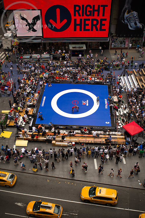 Jun 07, 2012 : Santo Curatolo (winner, in blue) and Danny Amancio compete in a youth exhibition wrestling match in Times Square as part of the Beat The Streets 2012 Gala and Benefit. Beat The Streets is a New York City-based not-for-profit organization that has brought wrestling to thousands of middle and high school students in the city. Credit:  Rob Bennett for The Wall Street Journal Slug: TSWrestle
