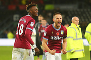 Aston Villa midfielder Conor Hourihane (14) and Aston Villa's Tammy Abraham (18) celebrate after the final whistle during the EFL Sky Bet Championship match between Derby County and Aston Villa at the Pride Park, Derby, England on 10 November 2018.