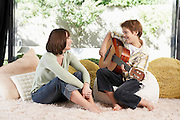 Boy Playing Guitar for His Mother