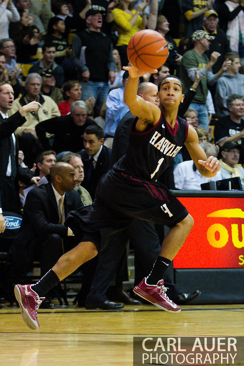 November 24th, 2013:  Harvard Crimson sophomore guard Siyani Chambers (1) receives the ball in the second half of action in the NCAA Basketball game between the Harvard Crimson and the University of Colorado Buffaloes at the Coors Events Center in Boulder, Colorado