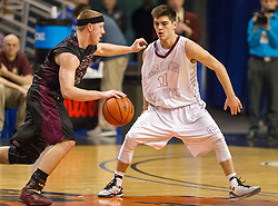 Wheeling Central guard Trenton Smith (11) tries to guard Williamstown forward Landon Travis (22) during a semi-final game at the Charleston Civic Center.