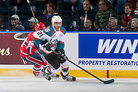 KELOWNA, CANADA - FEBRUARY 17: Devante Stephens #21 of the Kelowna Rockets skates with the puck against the Spokane Chiefs on February 17, 2017 at Prospera Place in Kelowna, British Columbia, Canada.  (Photo by Marissa Baecker/Shoot the Breeze)  *** Local Caption ***