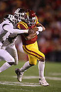25 OCTOBER 2008: Iowa State quarterback Austen Arnaud (4) is hit by the defenders in the first half of an NCAA college football game between Iowa State and Texas A&M, at Jack Trice Stadium in Ames, Iowa on Saturday Oct. 25, 2008. Texas A&M beat Iowa State 49-35.