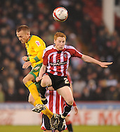 Sheffield - Saturday January 9th, 2009: Greg Halford of Sheffield United and Sammy Clingan of Norwich City during the Coca Cola Championship match at Bramall Lane, Sheffield. (Pic by Alex Broadway/Focus Images)