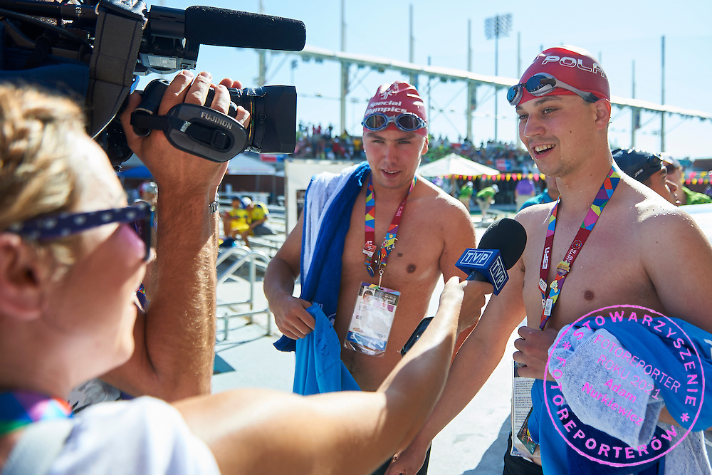 (L) Andrzej Motyka and (R) Sebastian Wilman SO Poland athletes while their interview after 25 meters backstroke competition during second day of the Special Olympics World Games Los Angeles 2015 on July 26, 2015 on Uytengsu Aquatics Centre at University of Southern California in Los Angeles, USA.<br /> USA, Los Angeles, July 26, 2015<br /> <br /> Picture also available in RAW (NEF) or TIFF format on special request.<br /> <br /> For editorial use only. Any commercial or promotional use requires permission.<br /> <br /> Adam Nurkiewicz declares that he has no rights to the image of people at the photographs of his authorship.<br /> <br /> Mandatory credit:<br /> Photo by &copy; Adam Nurkiewicz / Mediasport