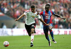 Marcus Rashford of Manchester United goes past Pape N'Diaye Souare of Crystal Palace - Mandatory by-line: Robbie Stephenson/JMP - 21/05/2016 - FOOTBALL - Wembley Stadium - London, England - Crystal Palace v Manchester United - The Emirates FA Cup Final