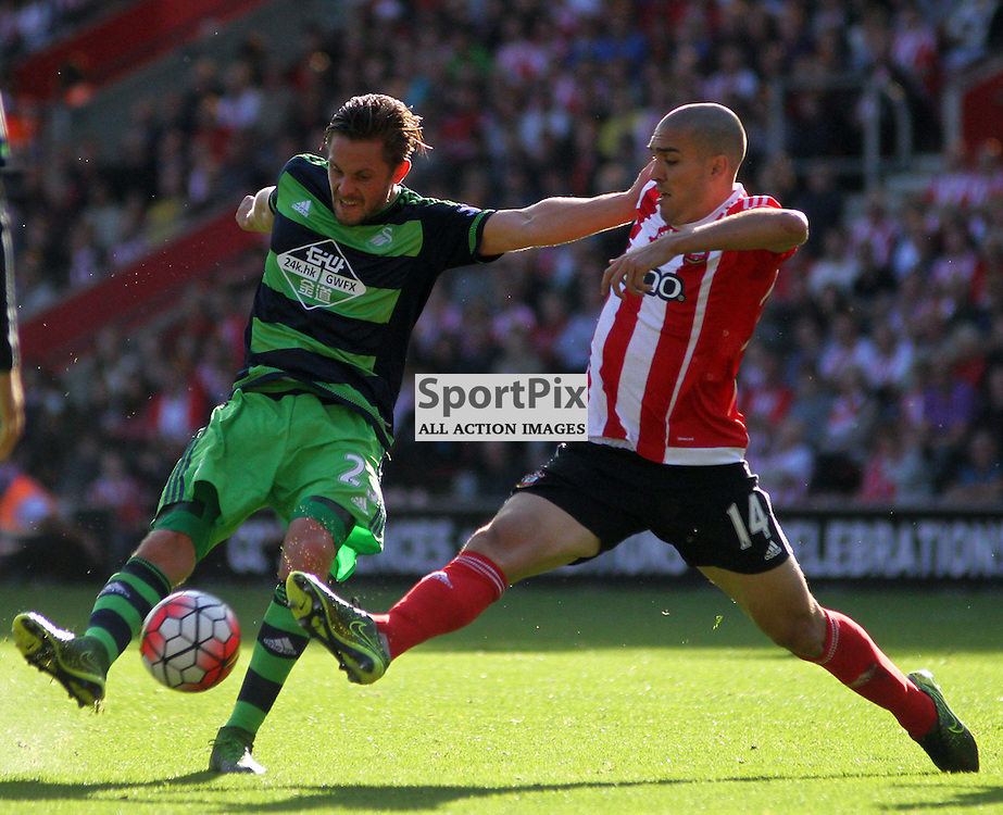 Oriol Romeu moves to block the effort of Gylfi Sigurdsson During Southampton vs Swansea on Saturday 26th September 2015.