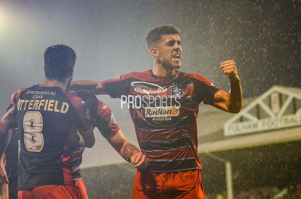 Tommy Smith celebrates in front of fans following Joel Lynch's equaliser during the Sky Bet Championship match between Fulham and Huddersfield Town at Craven Cottage, London, England on 8 November 2014.