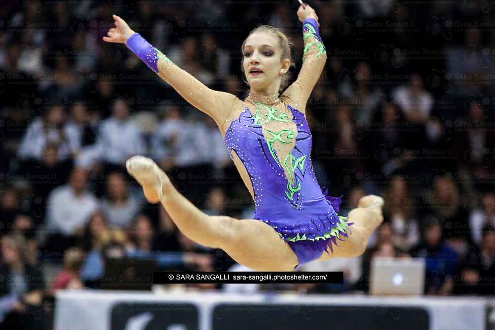 BIELLA, ITALY - NOVEMBER 15 2014: Cristiana Berruti of Eurogymnica performs with ribbon at the italian national rhythmic gymnastic championship. Her score in the apparatus is 12,550. Her team's score is 78,300 and ended up in fifth position.