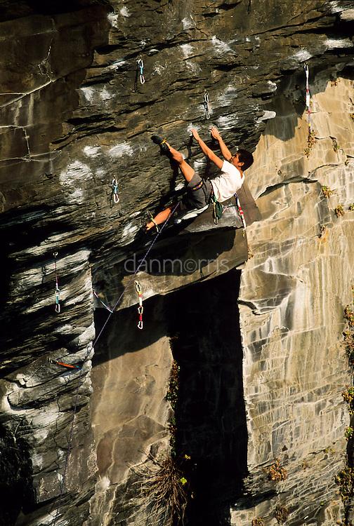 Masaaki Ikeda climbing on Tora no Ana, 5.13a at the sea cliffs of Jogasaki, Japan