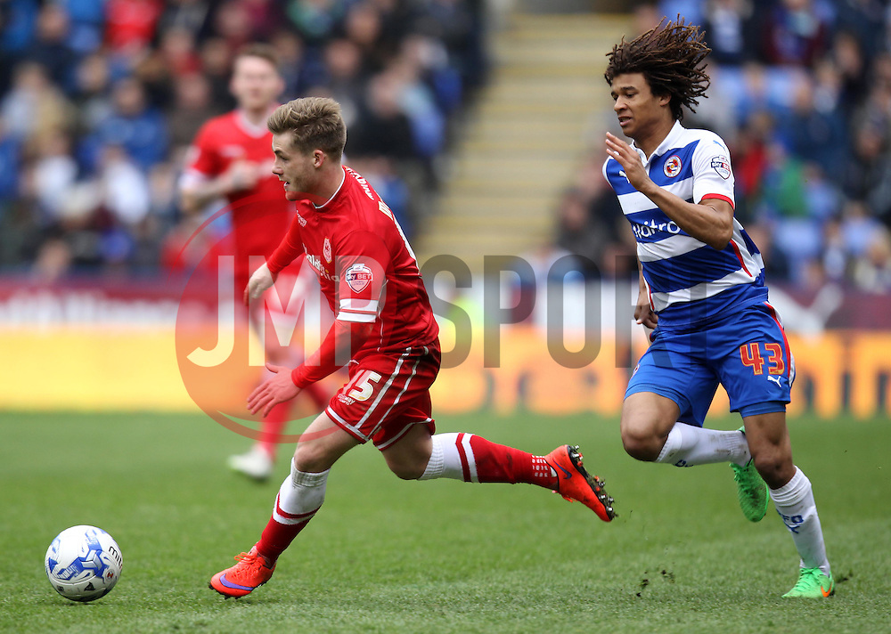 Cardiff City's Conor McAleny goes past Reading's Nathan Ake - Photo mandatory by-line: Robbie Stephenson/JMP - Mobile: 07966 386802 - 04/04/2015 - SPORT - Football - Reading - Madejski Stadium - Reading v Cardiff City - Sky Bet Championship
