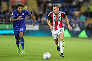 Paul Coutts of Sheffield United and Nathaniel Mendez-Laing of Cardiff City during the EFL Sky Bet Championship match between Cardiff City and Sheffield Utd at the Cardiff City Stadium, Cardiff, Wales on 15 August 2017. Photo by Andrew Lewis.