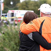 Davedda, left, and Chris Marshall, both of The Woodlands, Texas, console each other. A crash occurred at the intersection of Hall of Fame and Main streets during the OSU homecoming parade on Oct. 24, 2015, in Stillwater, Oklahoma. Kurt Steiss/O'Colly