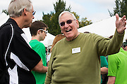 John Keifer, College of Busniess alumni, interacts with Ken Hartung at the College of Business Tailgate event during Ohio University's Homecoming 2013 Tailgate. Photo by Elizabeth Held