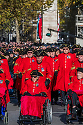 Veterans, incl Chelsea Pensioners, march past the Cenothaph and down Whitehall - Remembrance Sunday and Armistice Day commemorations fall on the same day, remembering the fallen of all conflicts but particularly the centenary of the end of World War One.