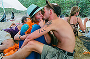 Two festival goers kissing, BulgariaTek, Bulgaria, August 2012