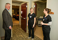 Wayne Bennett gets a tour of the newly opened LRGHealthcare Mothers' Milk Dispensary from RN Bethany Abbott and CMA Paige Burlingame during their open house Wednesday evening.  (Karen Bobotas/for the Laconia Daily Sun)