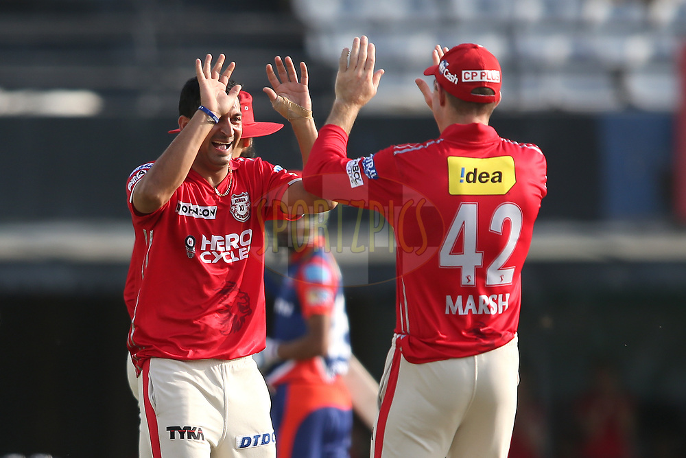 Mohit Sharma of Kings XI Punjab is congratulated by Shaun Marsh of Kings XI Punjab for getting Shahbaz Nadeem of the Delhi Daredevils wicket during match 36 of the Vivo 2017 Indian Premier League between the Kings XI Punjab and the Delhi Daredevils held at the Punjab Cricket Association IS Bindra Stadium in Mohali, India on the 30th April 2017<br /> <br /> Photo by Shaun Roy - Sportzpics - IPL