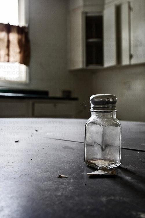 Old salt shaker in abandoned warehouse