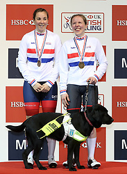 Lora Fachie (right) with Pilot Corrine Hall (left) and guide dog Tai, after winning gold in the Mixed Para Cycling BVI Pursuit, during day two of the HSBC UK National Track Championships at The National Cycling Centre, Manchester.