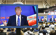 US Republican Presidential Candidate Donald Trump is seen on television in the CNN filing room during the Republican Presidential Debate at the University of Houston in Houston, Texas on February 25, 2016.
