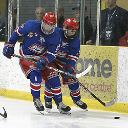 COCHRANE, ON - MAY 4: Tanner McEachern #27 of the Oakville Blades and Ryan O'Hara #25 pursue on the play during the first period on May 4, 2019 at Tim Horton Events Centre in Cochrane, Ontario, Canada.<br /> (Photo by Tim Bates / OJHL Images)
