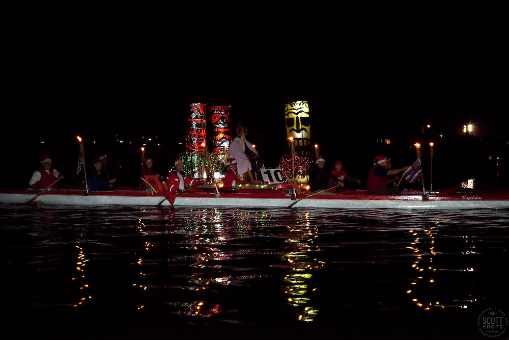 "Ventura Harbor 2009 Parade of Lights ""Holiday Tropical Tiki Party"". Boats decorated in Holiday lights on parade."