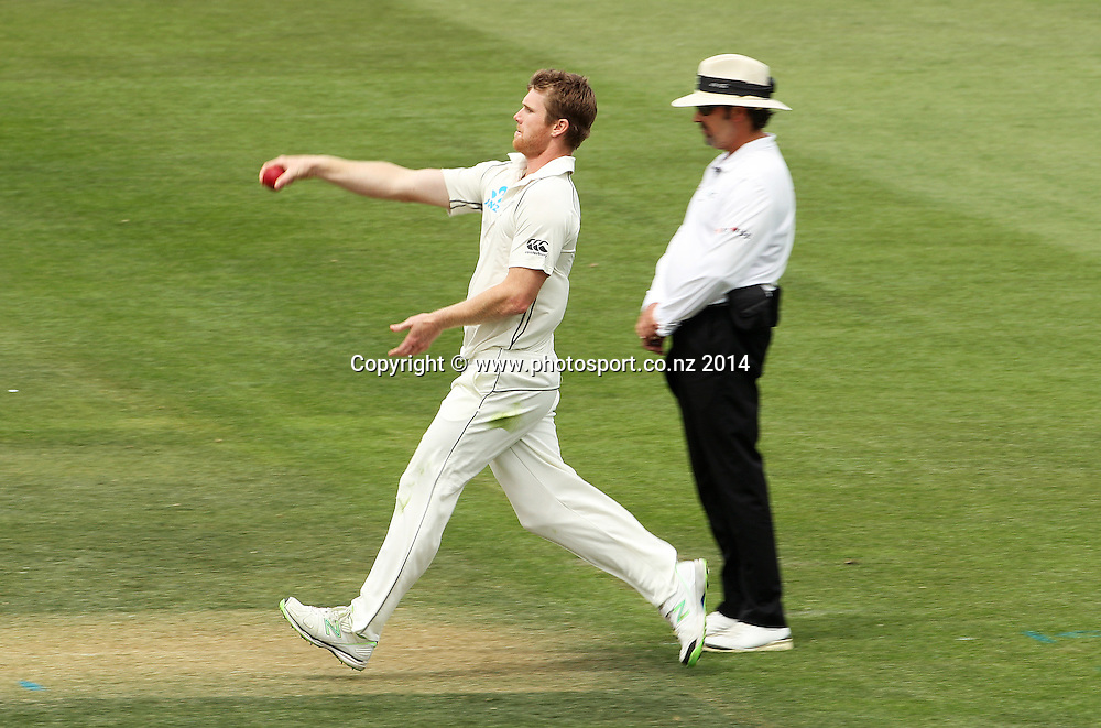 Jimmy Neesham of the Black Caps bowling on Day 2 of the boxing Day Cricket Test Match between the Black Caps v Sri Lanka at Hagley Oval, Christchurch. 27 December 2014 Photo: Joseph Johnson / www.photosport.co.nz