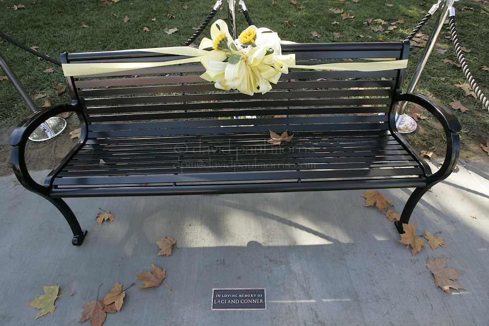 Modesto, CA - NOVEMBER 20: The park bench that was dedicated to Laci and Conner in Escalon, California. Over 2,000 people take part in the second annual Laci Peterson Memorial Motorcycle ride in Modesto, California on Saturday November 20, 2004. Laci was murdered along with her unborn son, Conner in December 2002 by her husband Scott Peterson who was found guilty of  first degree of murder by a San Mateo, California jury on November 12, 2004 and could face the death penalty. Photograph by David Paul Morris