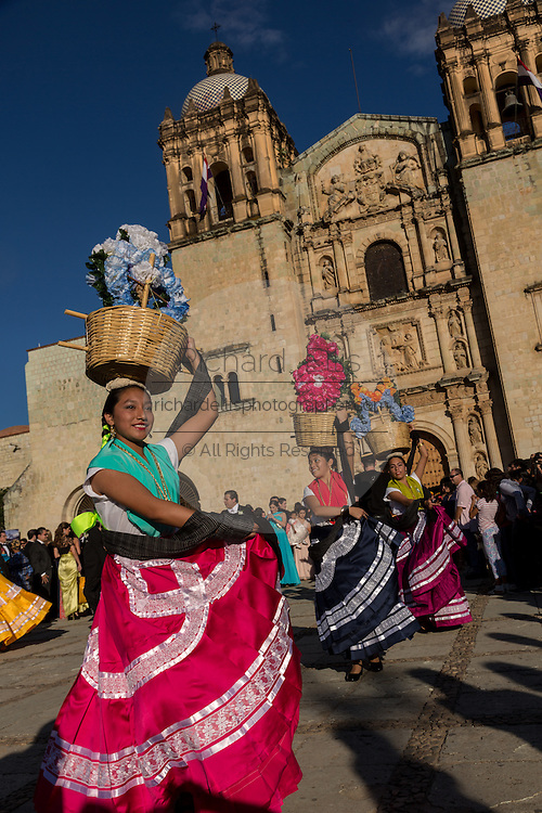 A traditional costumed folk dancer performs in front of the Santo Domingo Church during the Day of the Dead Festival known in spanish as Día de Muertos on October 257, 2014 in Oaxaca, Mexico.