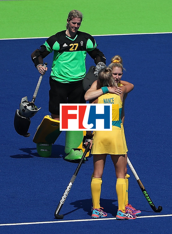 RIO DE JANEIRO, BRAZIL - AUGUST 15:  (L-R) Goalkeeper Rachael Lynch #27, Gabi Nance #1 and Kirstin Dwyer #6 of Australia react after being defeated 4-2 to New Zealand in the quarter final hockey game on Day 10 of the Rio 2016 Olympic Games at the Olympic Hockey Centre on August 15, 2016 in Rio de Janeiro, Brazil.  (Photo by Christian Petersen/Getty Images)