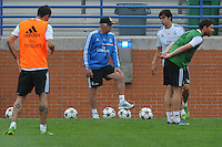 Football - Real Madrid Training for St. Louis Game against Inter Milan.  The Real Madrid team held a practice session on Thursday August 8, 2013 in St. Louis, Missouri, USA at the Robert Hermann Stadium located on the campus of St. Louis University in St. Louis.  Head coach Carlo Ancelloti (center) with players during a break in the training drills.