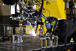 An employee at ESAB demonstrates Hybird Laser Welding at their facility in Florence. A laser, moving through a fiber optic cable, is used to weld thick pieces of metal together.