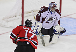 Oct 15; Newark, NJ, USA; New Jersey Devils left wing Ilya Kovalchuk (17) scores a goal through the legs of Colorado Avalanche goalie Craig Anderson (41) during the third period at the Prudential Center. The Avalanche defeated the Devils 3-2.