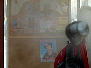 Maedchen wartet auf ihren Bus an einer Haltestelle im Zentrum von Jakutsk. Jakutsk hat 236.000 Einwohner (2005) und ist Hauptstadt der Teilrepublik Sacha (auch Jakutien genannt) im Foederationskreis Russisch-Fernost und liegt am Fluss Lena. Jakutsk ist im Winter eine der kaeltesten Grossstaedte weltweit mit durchschnittlichen Winter Temperaturen von -40.9 Grad Celsius. Die Stadt ist nicht weit entfernt von Oimjakon, dem Kaeltepol der bewohnten Gebiete der Erde. Die Stadt ist nicht weit entfernt von Oimjakon, dem Kaeltepol der bewohnten Gebiete der Erde.<br /> <br /> Girl waiting for a bus in the centre of Yakutsk. Yakutsk is a city in the Russian Far East, located about 4 degrees (450 km) below the Arctic Circle. It is the capital of the Sakha (Yakutia) Republic (formerly the Yakut Autonomous Soviet Socialist Republic), Russia and a major port on the Lena River. Yakutsk is one of the coldest cities on earth, with winter temperatures averaging -40.9 degrees Celsius.